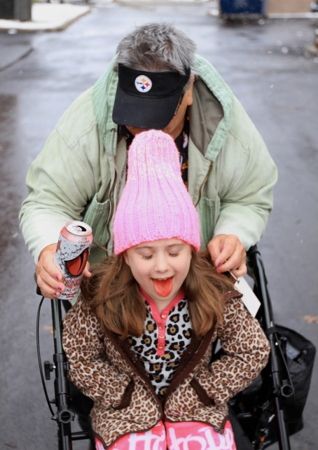 Linda O'Roark, 54, (back) pushes Adrianna, 7, on her walker on the way to the car on Sunday, Nov. 20, 2016 in Alliance, Ohio