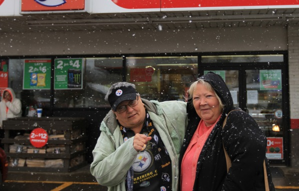 Linda O'Roark (left) and Robin Conrad (left) pose for a portrait outside a Circle K store in Alliance, Ohio. The store used to be a Dairy Mart and it is where Linda worked for Robin and where they became close.