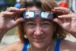 Terry Nadeau, 54, poses for a portrait outside the Reed Memorial Library in Ravenna, Ohio on Monday, August 21, 2017. Nadeau was out watching the second total eclipse in her life time and she remembers her mother screaming at her during the last eclipse to not look directly into the sun or she would go blind.