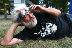 """Richard Koluds, 66, of Ravenna poses for a portrait while watching the solar sclipse on the front lawn of the Reed Memorial Library in Ravenna, Ohio on Monday, Aug. 21, 2017. Koluds came out to watch the eclipse because he is retired and """"has nothing better to do."""""""