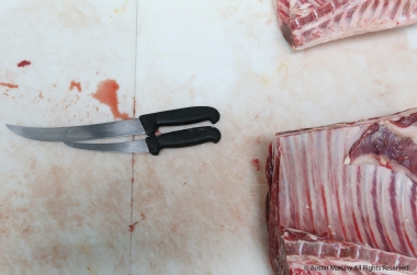 Butcher knives sit on the cutting board at Farmer's Rail in Bath, Ohio. Brunty Farms, a local farm, recently opened the new meat shop that sells high quality meats, seafood and cheeses.