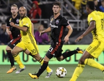 D.C. United midfielders Russell Canouse (left) and Ian Harkes (second from right) along with Columbus Crew midfielder Federico Higuain (second from left) and forward Ola Kamara run with the ball during a match in Columbus, Ohio on Saturday, Sept. 30, 2017.
