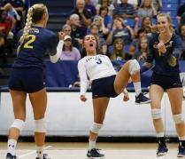 Kent defensive specialist Challen Geraghty celeberates with teammates after scoring during the match against Akron on Friday, Sept. 22, 2017. Kent went on to lose the game 3-1.