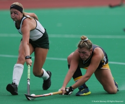 Michigan State University's junior forward Maggie Cole and Kent State's senior forward Courtney Weise both reach for the ball during a game at Michigan State University.