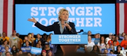 """Then Democratic presidential nominee Hillary Clinton gestures during a campaign stop in Akron, Ohio where she accepted the endorsement of NBA Superstar LeBron James saying """"I may become president but he will always be the king of Ohio."""""""