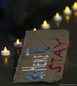 A handmade sign sits on the stage used for the candlelight vigil in support of DACA in Cleveland, Ohio on Thursday, Sept. 7, 2017.