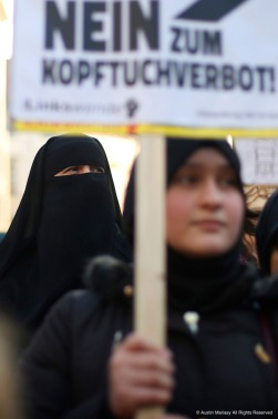 "A Muslim woman wearing a burka attends a protest in Vienna, Austria on Saturday, Feb. 4, 2017. The protest was in response to the Austrian Parliament's proposed ban on Muslim women wearing burkas and on Muslim women in the public sector wearing hijabs. The sign translates to ""no to the headscarf ban."""