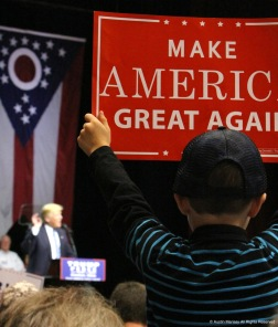 Ethan Wohlwend, 6, sits on his father's shoulders and holds a Trump sign during a campaign stop for the then Republican presidential nominee in Canton, Ohio on Wednesday, Sept. 14, 2016.