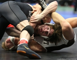 Ohio State's Joey McKenna and Lehigh's Luke Karam spar during a qualifying round of the NCAA Wrestling Championships. McKenna won and went on to defeat Bucknell's Tyler smith in the quarterfinals and will wrestle Wyoming's Bryce Meredith in the semifinal round.