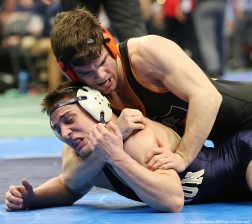 Princeton's Matthew Kolodzik wraps his arm around the neck of Clarion's Taylor Ortz during their bout at the NCAA Wrestling Championship in Cleveland, Ohio on Thursday, March 15, 2018.