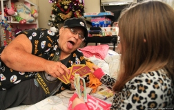 Linda O'Roark plays Old Maid with her goddaughter Adrianna, 7, in her apartment in Alliance, Ohio. O'Roark is a recovering alcoholic and has been sober for 27 years with the help of Alcoholics Anonymous and Adrianna.
