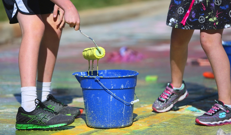 Kids play with colored water during the Kent Creativity Festival in downtown Kent, Ohio on Saturday, Sept. 30, 2017.