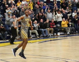 Kent State's sophomore forward Danny Pippen celebrates after scoring the go ahead basket against the University at Buffalo. The last minute scoring drive by the flashes lead to the Bull's first conference loss of the season with a final score of 68-65.