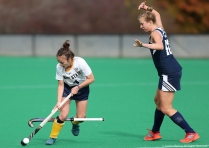 Kent State senior midfielder Jessica Nesbitt accidently rips the stick out of the hands of Longwood junior forward Leonie Verstraete during the MAC semifinal game in Kent, Ohio on Friday, Nov. 3 2017.
