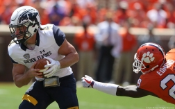 Kent State quarterback Nick Holley doges a sack by Clemson cornerback Marcus Edmond during Clemson's home opener on Saturday, Sept. 2, 2017.