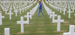 An American student walks through a cemetery for fallen Americans in Italy. The cemetery is the final resting place for thousands of Americans killed in World War 2.