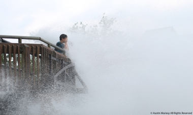 A boy shields his face from a wall of water at Cedar Point in Sandusky, Ohio on Thursday, July 20, 2017.