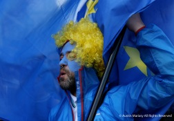 Martin Evans, 52, chants as he is enveolped in his European Union flag during a protest march against Brexit in London, England on Saturday, March 25, 2017.