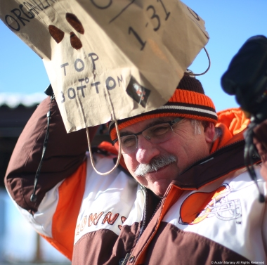 Gene Hauck places a bag on his head before the start of the Cleveland Brown's perfect season parade outside First Energy Stadium in Cleveland, Ohio on Saturday, Jan. 6, 2017.