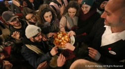 Florentines reach for free pizza during an event in the main market in Florence, Italy on Thursday, Jan. 27, 2017.