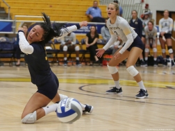 Kent State defensive specialist Challen Geraghty misses the ball during a game on Friday, Sept. 30, 2017.