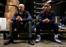 Penn State's Mark Hall sits next to his coach while preparing for his championship bout at the NCAA Wrestling Championship in Cleveland, Ohio. Hall lost the championship round to Zahid Valencia of Arizona State University and placed second in the 174 pound weight class.