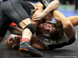 Ohio State's Joey McKenna and Lehigh's Luke Karam spar during a qualifying round of the NCAA Wrestling Championships. McKenna won and went on to defeat Bucknell's Tyler smith in the quarterfinals and lost to Wyoming's Bryce Meredith in the semi-final round. Mckenna placed third in the 141 pound weight class.