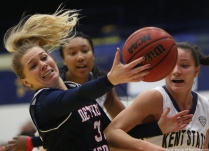 Detroit Mercy junior guard Gracie Roberts attempts to collect a rebound against Kent State University on Thursday, Nov. 30, 2017.