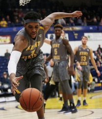 Kent junior guard Adonis De La Rosa attempts to keep the ball inbounds against Western Michigan University on Tuesday, Jan. 16, 2018.