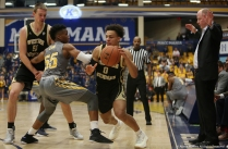 Western Michigan junior guard Bryce Moore attempts to drive passed Kent senior guard Kevin Zabo on Tuesday, Jan. 16, 2018.