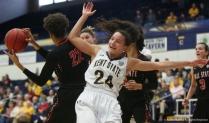Kent junior guard Alexa Golden falls after losing a rebound to Ball State senior guard Jasmin Samz on Saturday, Jan. 20, 2018.