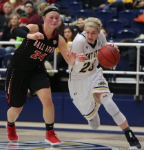 Kent sophomore guard Ali Pool drives to the basket against Ball State junior guard Jasmin Samz on Saturday, Jan. 20, 2018.