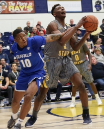 Kent sophomore forward Danny Pippen is fouled by Buffalo senior guard Wes Clark on Tuesday, Jan. 30, 2018.