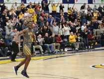 Kent sophomore forward Danny Pippen celebrates after scoring the go ahead basket to upset Buffalo and give them their first conference loss of the season on Tuesday, Jan. 30, 2018.
