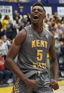 Kent sophomore forward Danny Pippen celebrates after it became apparent Kent was going to upset Buffalo after Buffalo's Ikenna Smart and Kent's Jaylin Walker were ejected for flagrant technical fouls which lead to Kent's Jalen Avery shooting, and making, two free throws putting Kent ahead by 7 with 20 seconds left in the game.