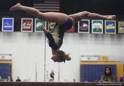 Kent freshman Abby Fletcher performs on the balance beam on Friday, Jan. 19, 2018.