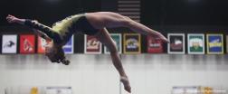 Kent freshman Abby Fletcher performs on the balance beam on Friday, Jan. 19, 2018.