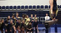 The Kent State gymnastics team watches as senior Rachel Stypinski performs on the balance beam on Friday, Jan. 19, 2018.