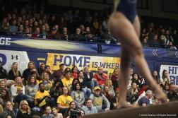 Kent freshman Nasha Manitkul-Davis performs on the balance beam on Friday, Jan. 19, 2018.