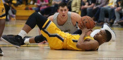 Kent senior guard Kevin Zabo recovers a loose ball from Akron freshman center Mark Kostelac.