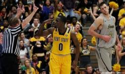 Kent junior guard Jalen Avery and Akron freshman center Mark Kostelac react to Avery's 3-point goal on Saturday, Feb. 17, 2018.