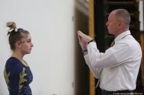 Kent junior Sarah Lippowitsch receives coaching from