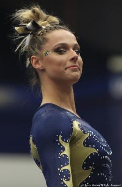 Kent freshman Abby Fletcher pauses during her floor routine on Jan. 19, 2018/