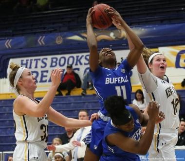 Buffalo sophomore guard Theresa Onwuka takes a rebound away from Kent graduate student forward Mckenna Stephens on Wednesday, Feb. 28, 2018.