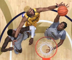 Kent freshman forward BJ Duling hits Akron junior guard Jimond Ivey in the face while he attempts to recover a rebound from Akron junior guard Lucas Smith on Friday, March 2, 2018.