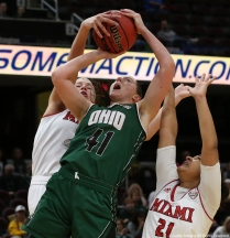 Miami University sophomore forward blocks the shot by Ohio University freshman forward Gabby Burris during the Mid-American Conference quarterfinal game in Cleveland, Ohio.