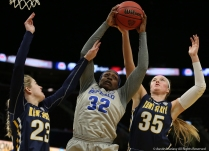 University at Buffalo junior forward Brittany Morrison recovers a rebound from Kent State sophomore guard Ali Poole (left) and senior forward Jordan Korinek during the Mid-American Conference quarterfinal game in Cleveland, Ohio.