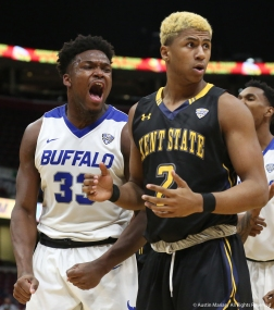 University at Buffalo junior forward Nick Perkins reacts after making a basket and getting fouled by Kent freshman forward BJ Duling in the Mid-American Conference semifinal game in Cleveland, Ohio.