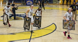 Kent State senior carry their memorabilia off the court after their recognition at senior night.