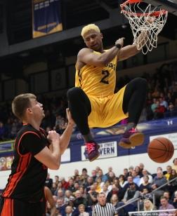 Kent freshman forward BJ Duling dunks on Bowling Green freshman forward Derek Koch on Saturday, Feb. 24, 2018.